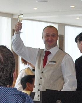 Waiter cheering with champagne on an AMAWaterways river cruise