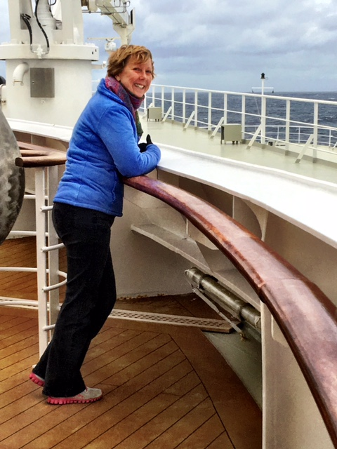 Woman on the Queen Mary 2 standing at the deck rail