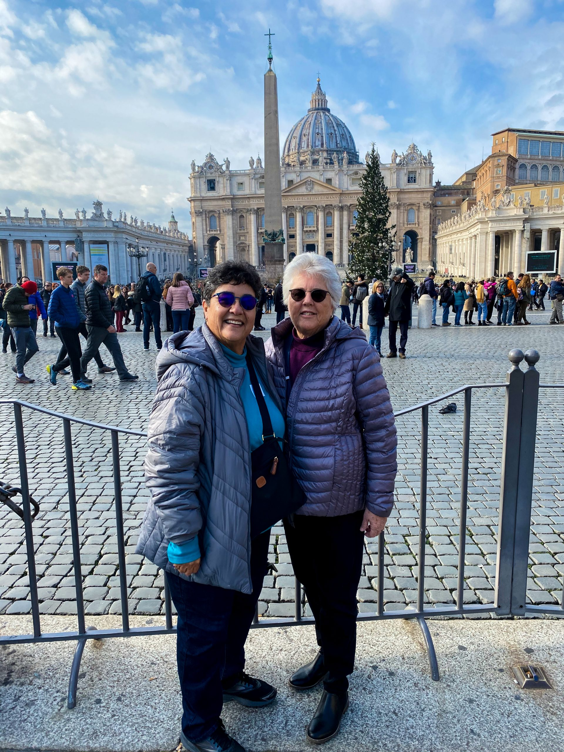 Two ladies standing in front of the Vatican in Rome