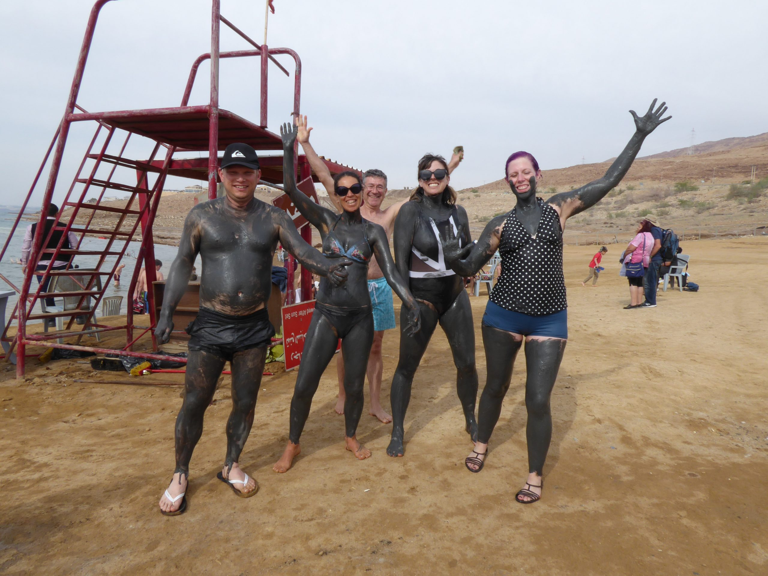 Covered in mud at the Dead Sea in Jordan
