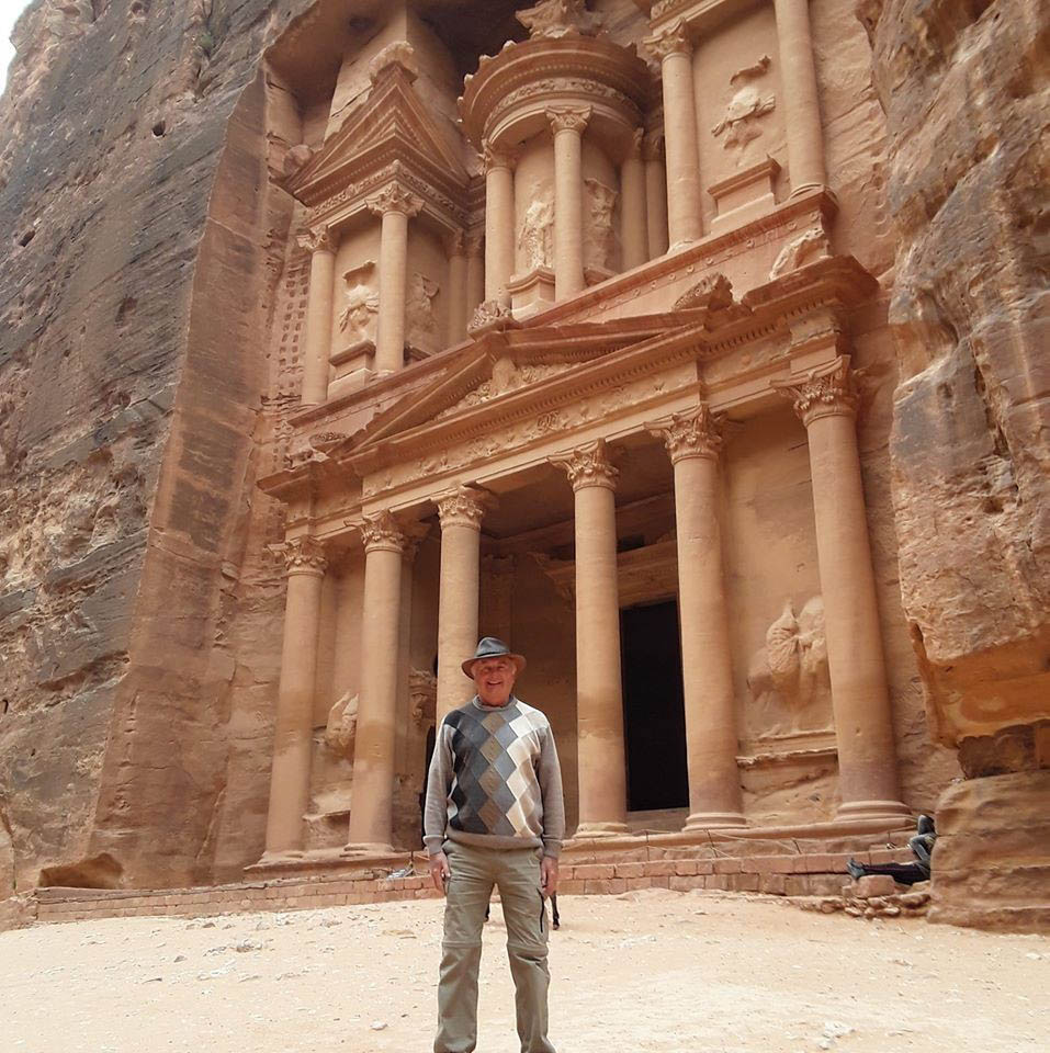 Man standing in front of Treasury Building in Petra