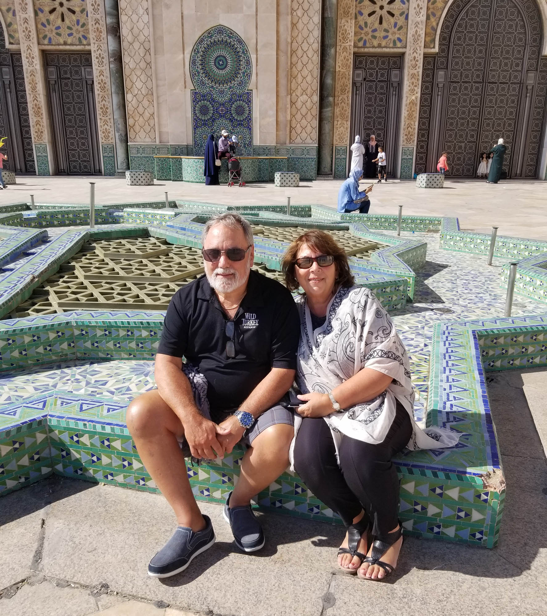 Couple sitting near a fountain in a Mosque in Morocco