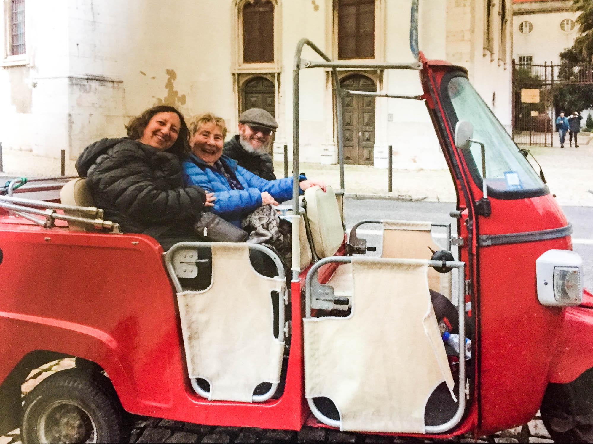 3 people in Tuktuk in Lisbon Portugal