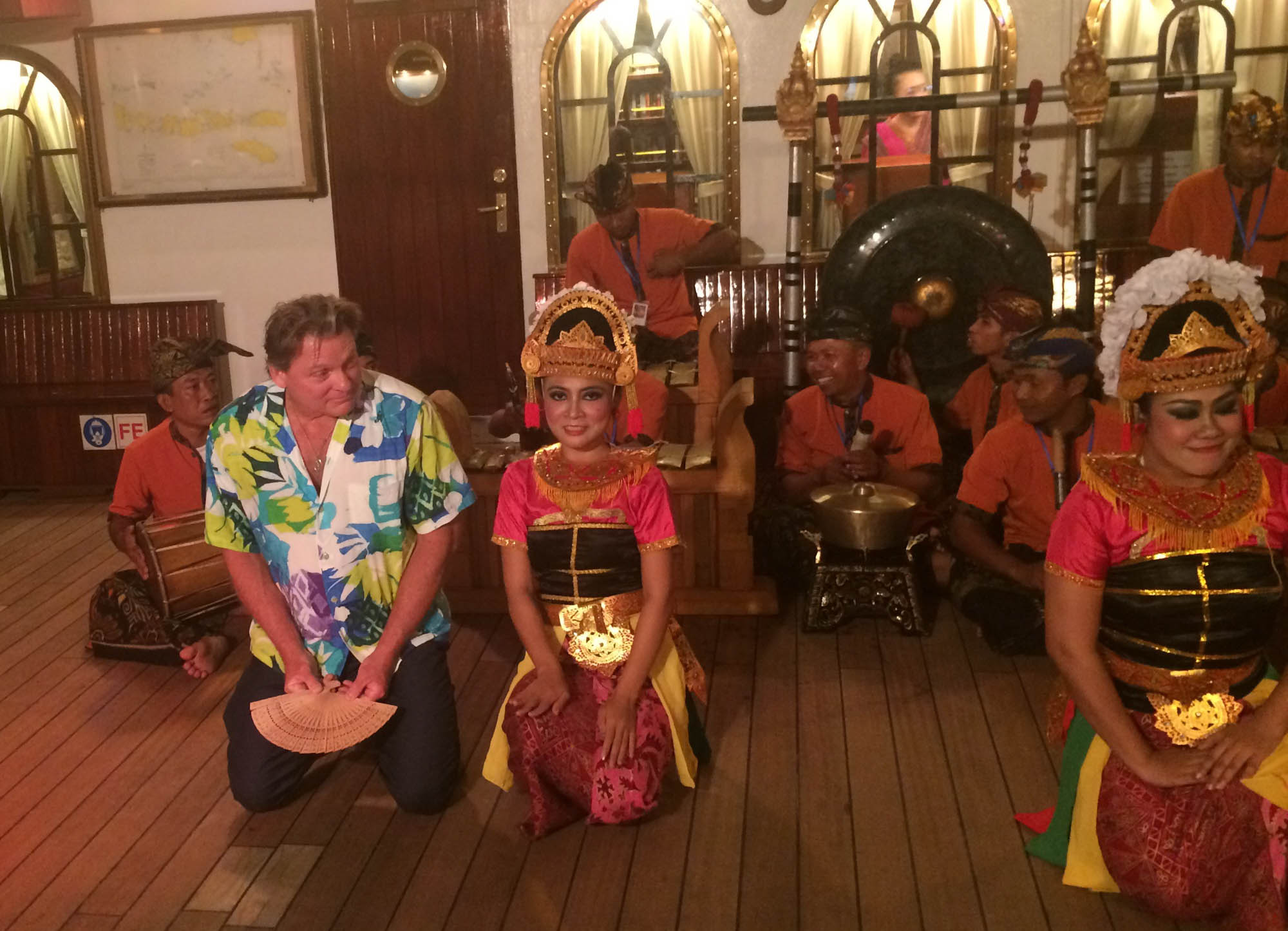 Man in Bali with local musicians and dancers