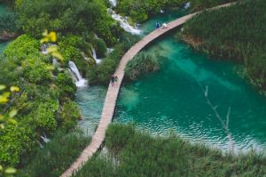 Overhead view of plitvice lakes walkway across a lake with waterfalls