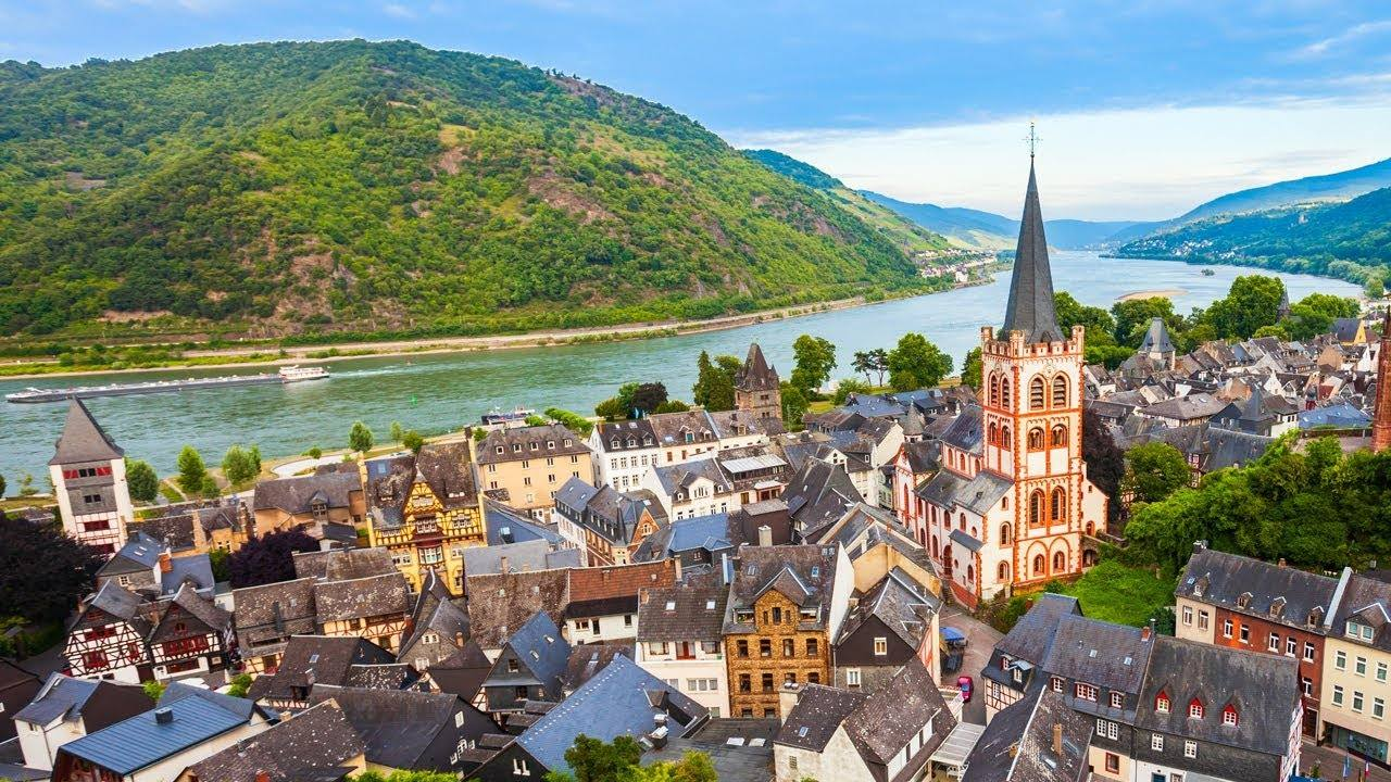Rhine river with town buildings and steeple in the foreground.