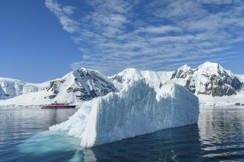 ship amongst the ice in antarctica
