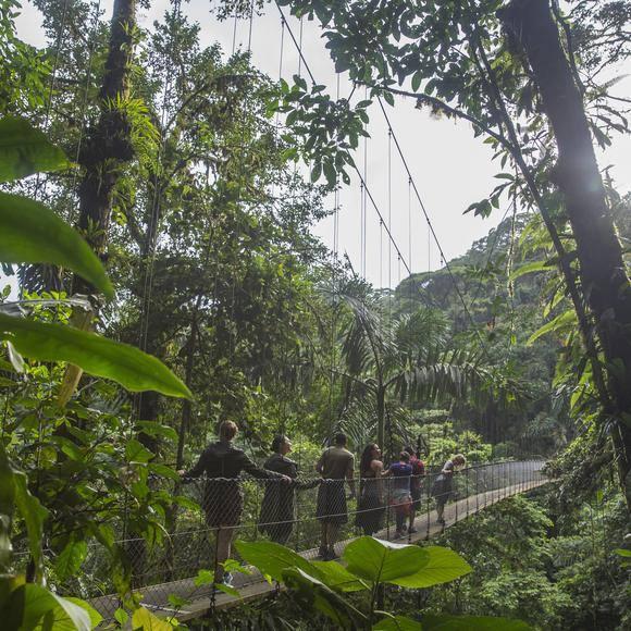 People crossing suspension bridge in Costa Rica