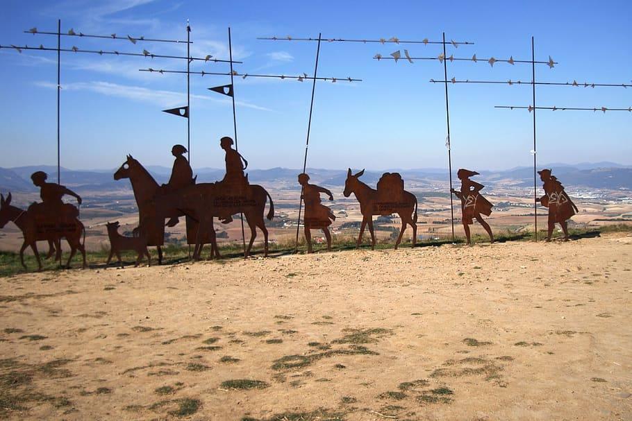 monument showing the pilgrims on the camino de santiago