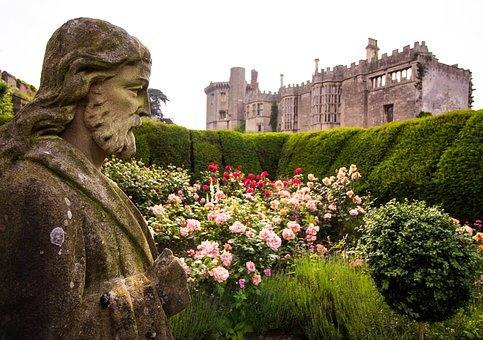 statue with thornbury castle in the background