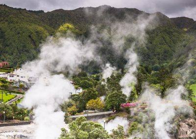 Green valley with thermal steam vents