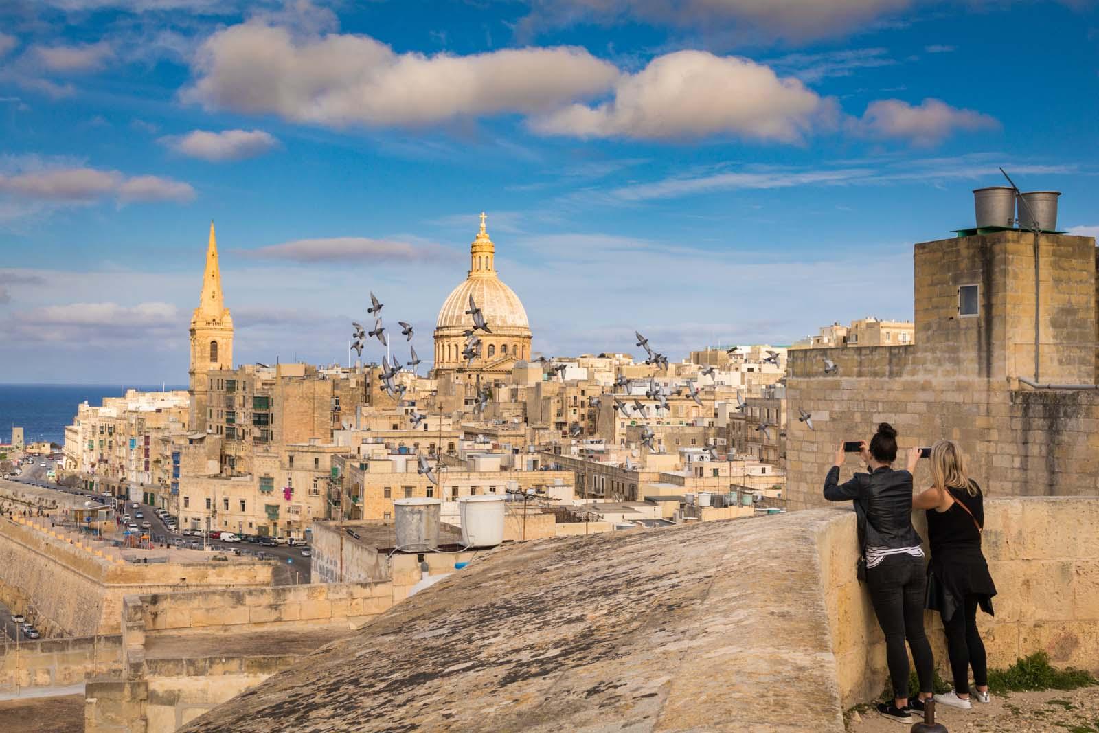 People taking picture of VAlletta Malta